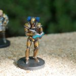 Painted Doty Miniature from the Critical Role Kickstarter by Steamforged with Taryon Darrington in Background